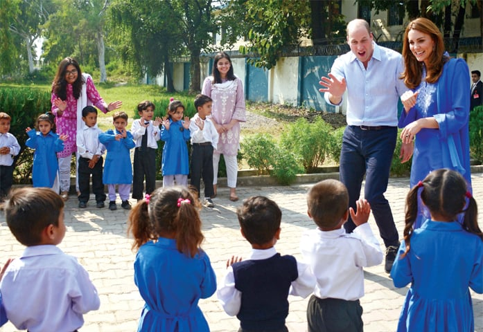 The duke and duchess of Cambridge greet schoolchildren during their visit to Islamabad Model School for Girls, Quaid-i-Azam University Colony, on Wednesday. — Photo by Tanveer Shahzad