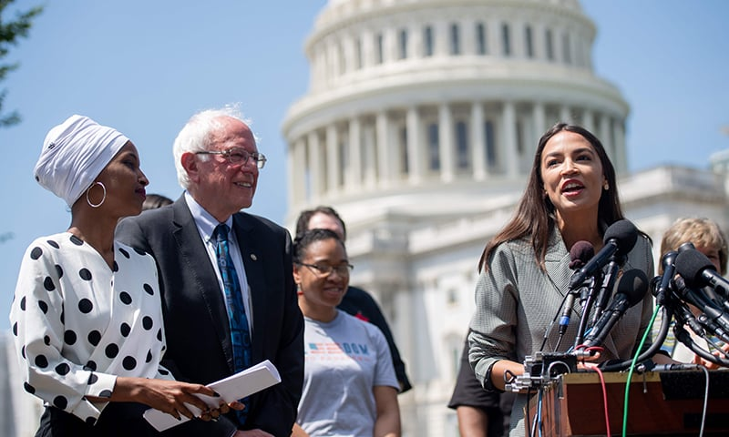 In this photo taken on June 24, 2019 Representative Alexandria Ocasio-Cortez (2nd R), Democrat of New York, speaks alongside US Senator Bernie Sanders (2nd L), Independent of Vermont, and Representative Ilhan Omar (L), Democrat of Minnesota, during a press conference to introduce college affordability legislation outside the US Capitol in Washington, DC. — AFP