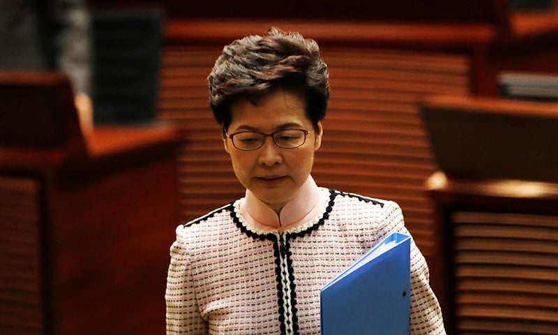 Hong Kong Chief Executive Carrie Lam reacts as lawmakers shout slogans, disrupting her annual policy address at the Legislative Council in Hong Kong, China on October 16, 2019. — Reuters