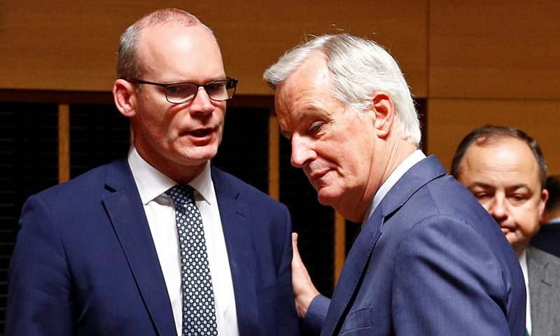 EU's Chief Brexit Negotiator Michel Barnier talks with Irish Foreign Minister Simon Coveney during the General Affairs council addressing the state of play of Brexit, in Luxembourg on October 15, 2019. — Reuters