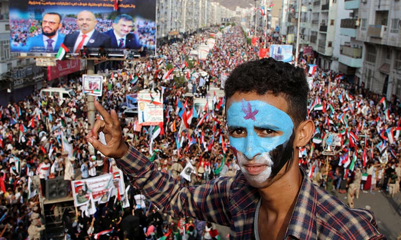 Asupporter of Yemen's southern separatists with his face painted with the colours of the former South Yemen, makes the V sign during a rally in support to the United Arab Emirates amid a standoff with the Saudi-backed government, in the port city of Aden, Yemen on September 5, 2019. — Reuters