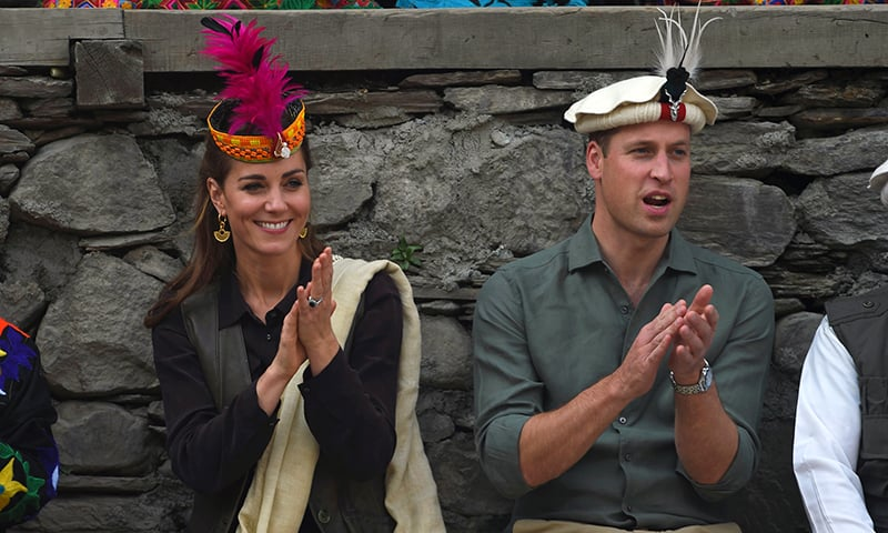 Britain's Prince William (R), Duke of Cambridge and his wife Catherine, Duchess of Cambridge, watch a traditional Kalashi dance during their visit to theBombaret Valley in Chitral on Wednesday. — AFP