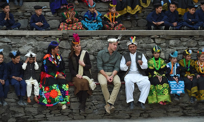 Britain's Prince William (centre R), Duke of Cambridge and his wife Catherine (centre L), Duchess of Cambridge, watch a traditional Kalashi dance during their visit to the Bombaret Valley in Chitral on Wednesday. — AFP
