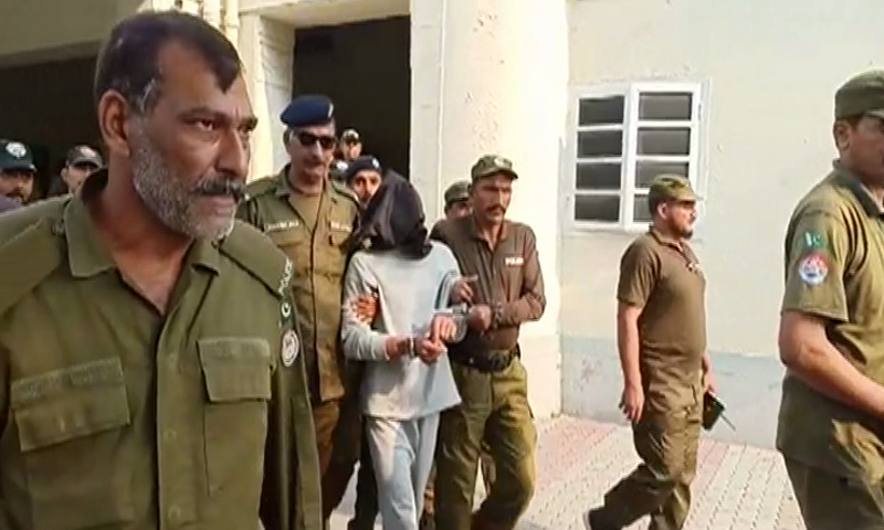 Suspect Suhail Shehzad being brought into the court by police with a black hood over his head. — DawnNewsTV