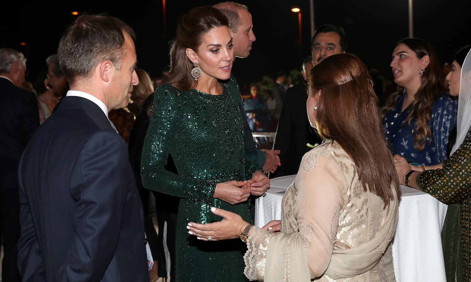 Britain's Prince William and Catherine, Duchess of Cambridge, speak with guests as they attend a reception hosted by the British High Commissioner to Pakistan, Thomas Drew, at the Pakistan National Monument in Islamabad. — Reuters