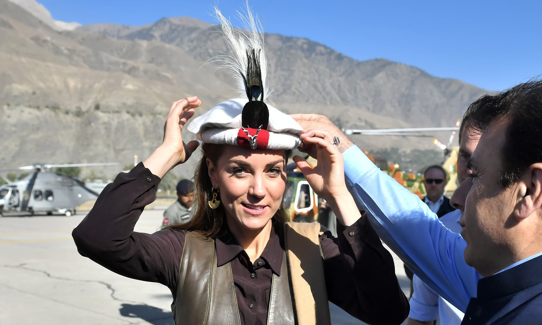 Catherine, Duchess of Cambridge receives a traditional cap in Chitral, October 16. — Reuters