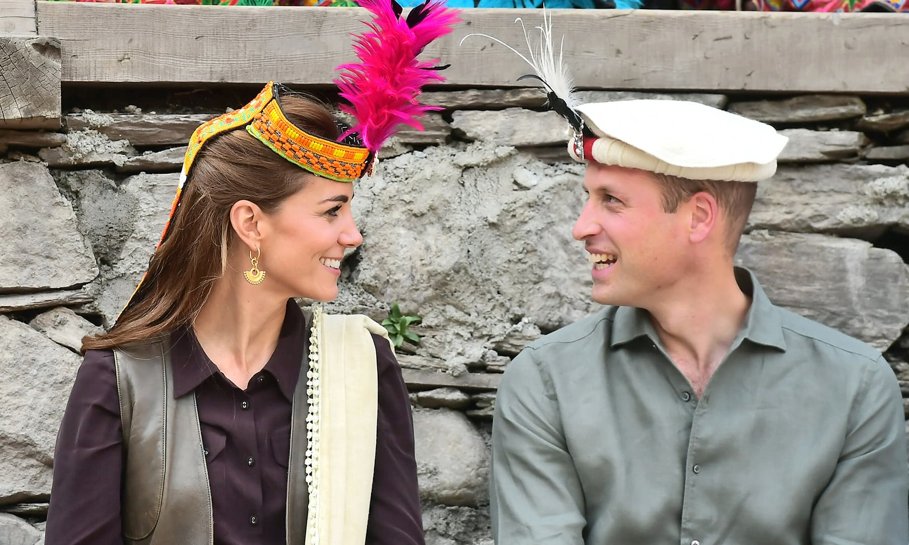 Prince William and Catherine, Duchess of Cambridge look at each other while visiting a settlement of the Kalash people in Chitral, October 16. — Reuters
