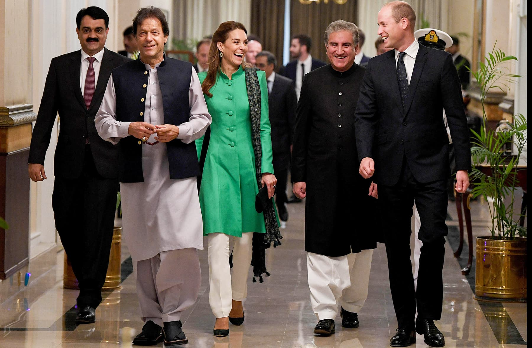 Prince William and Catherine walk alongside Prime Minister Imran Khan in Islamabad, October 15. — Reuters