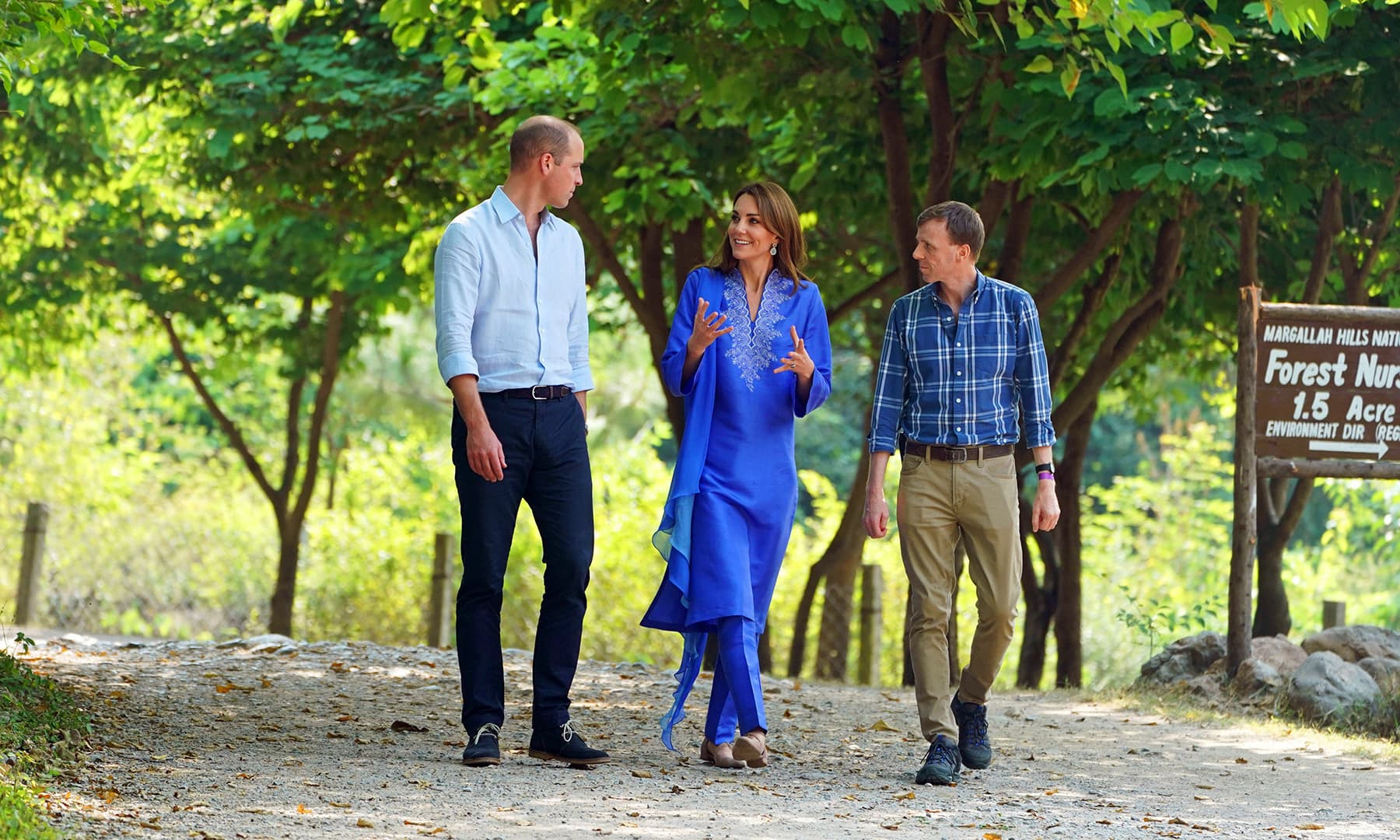 Prince William and Catherine, Duchess of Cambridge walk with an unidentified man during a visit to the Margalla Hills in Islamabad, October 15. — Reuters