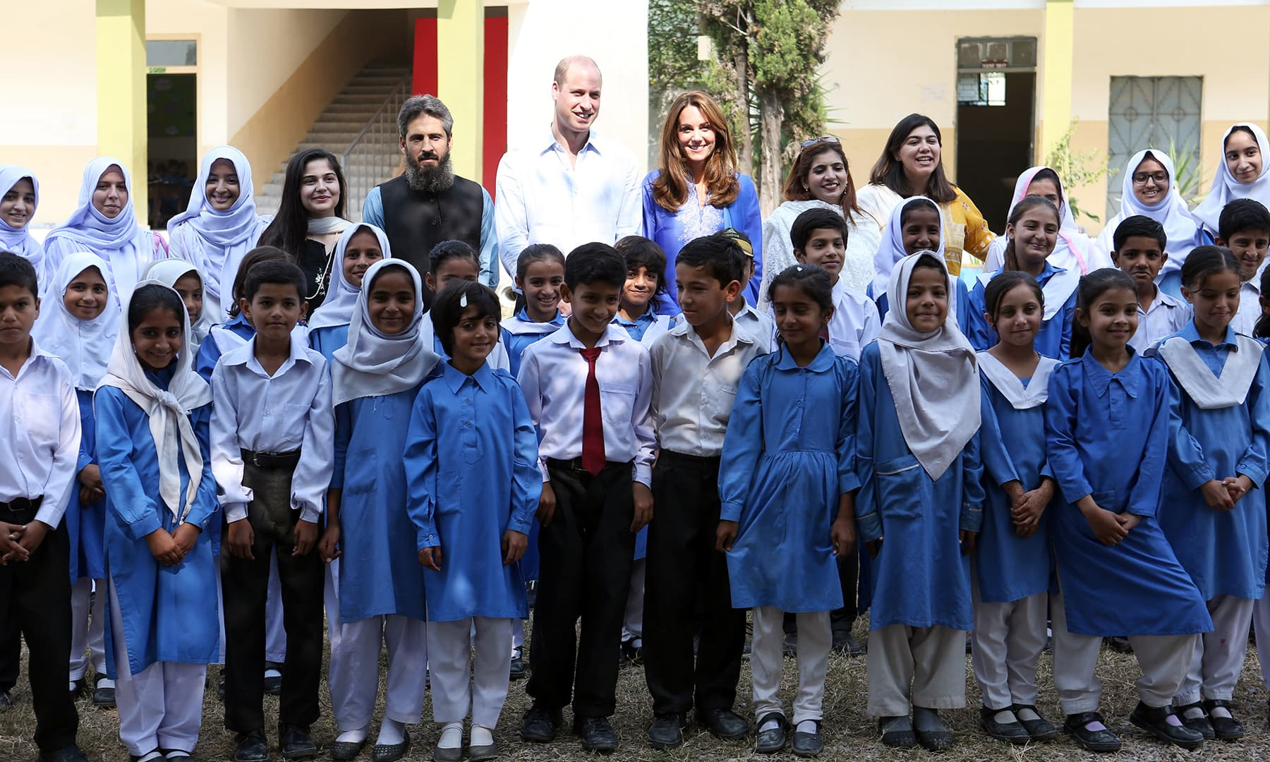 Prince William and Catherine, Duchess of Cambridge pose for a group photo with staff and students at a school during a trip to Islamabad, October 15. — Reuters