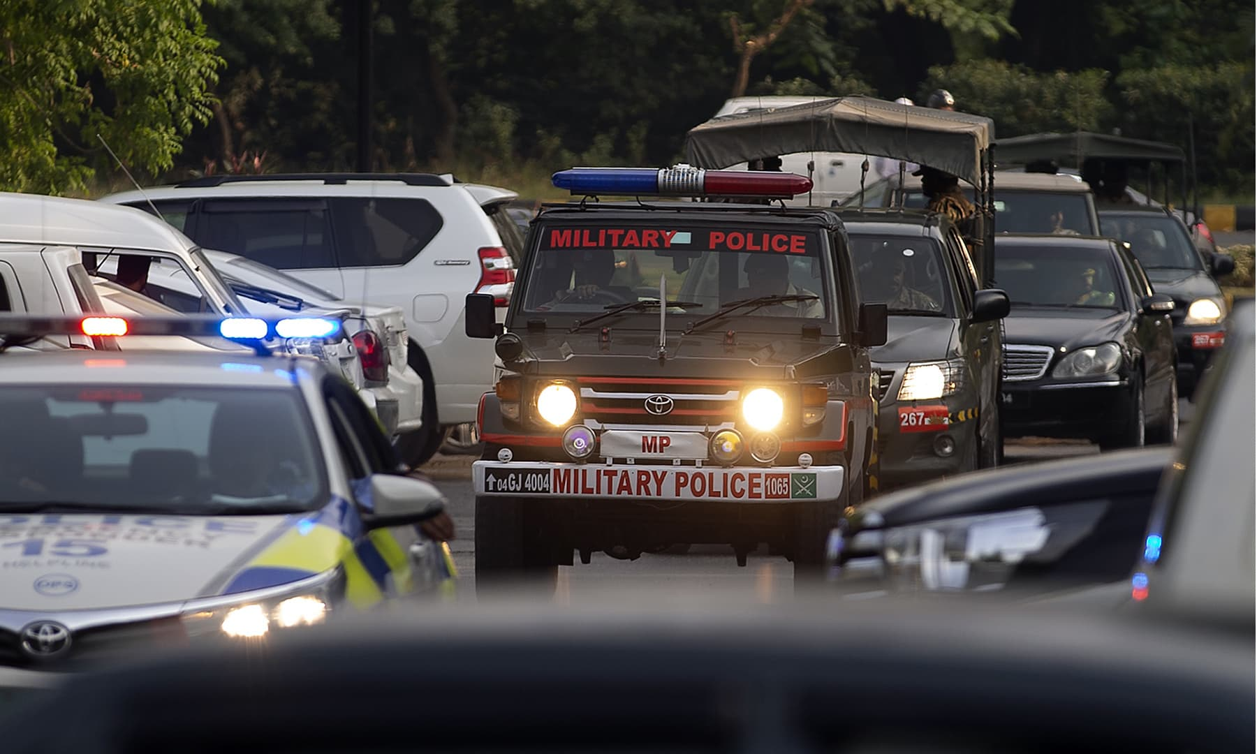 The motorcade of the British royal couple leaves a hotel under tight security in Islamabad, October 15. — AP