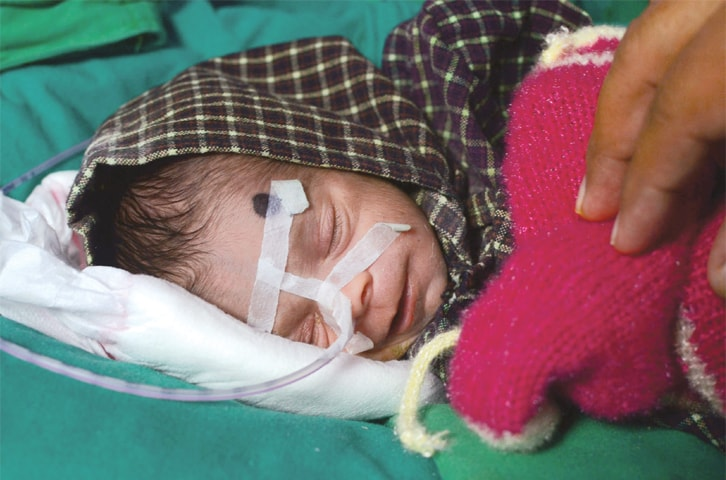 Bareilly: The baby rests at a hospital where she is recovering after being found buried alive in an earthen pot.—AFP
