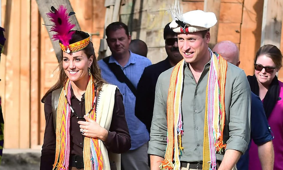 Britain's Prince William and his wife Catherine, Duchess of Cambridge, visit a settlement of the Kalash people in Chitral on Wednesday. — Reuters