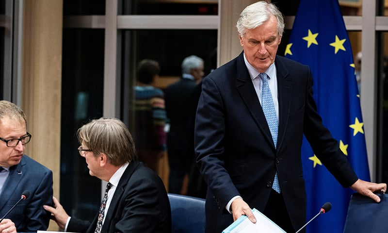 European Union's chief Brexit negotiator Michel Barnier (R) arrives for a meeting at the European Parliament in Brussels, on October 16, 2019. — AFP