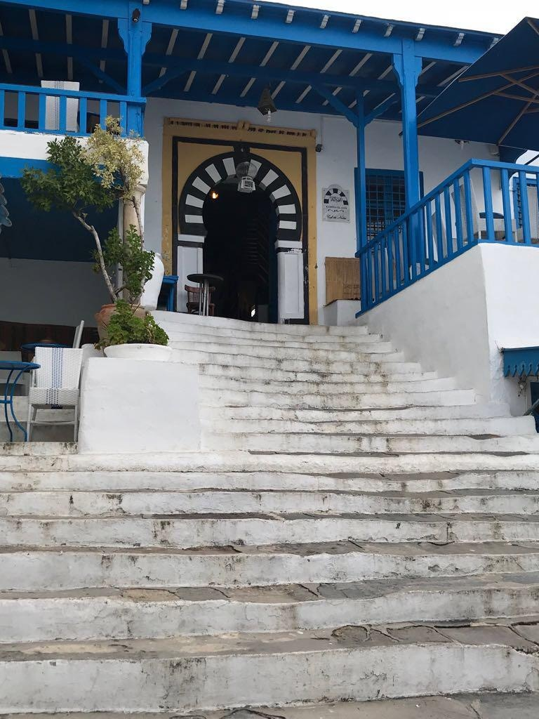 The stairs leading to Cafe des Nattes are a popular spot for having tea in warmer weather.