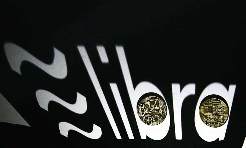 Shadow of a 3D-printed Facebook Libra cryptocurrency logo is seen near cryptocurrency representation in this illustration taken, September 13, 2019. — Reuters/File