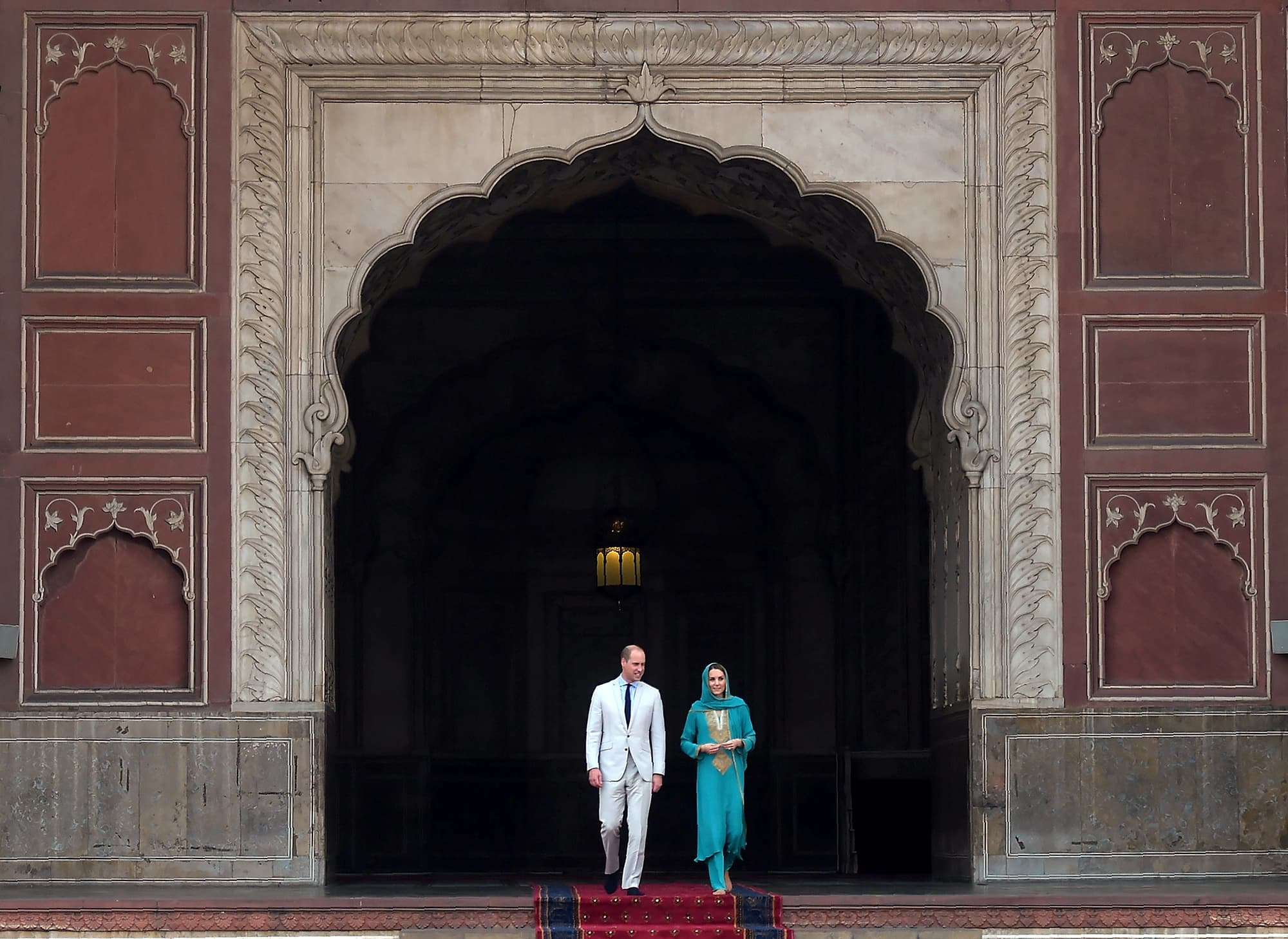 Britain's Prince William, Duke of Cambridge and his wife Catherine, Duchess of Cambridge visit the historical Badshahi mosque in Lahore on October 17. — AFP
