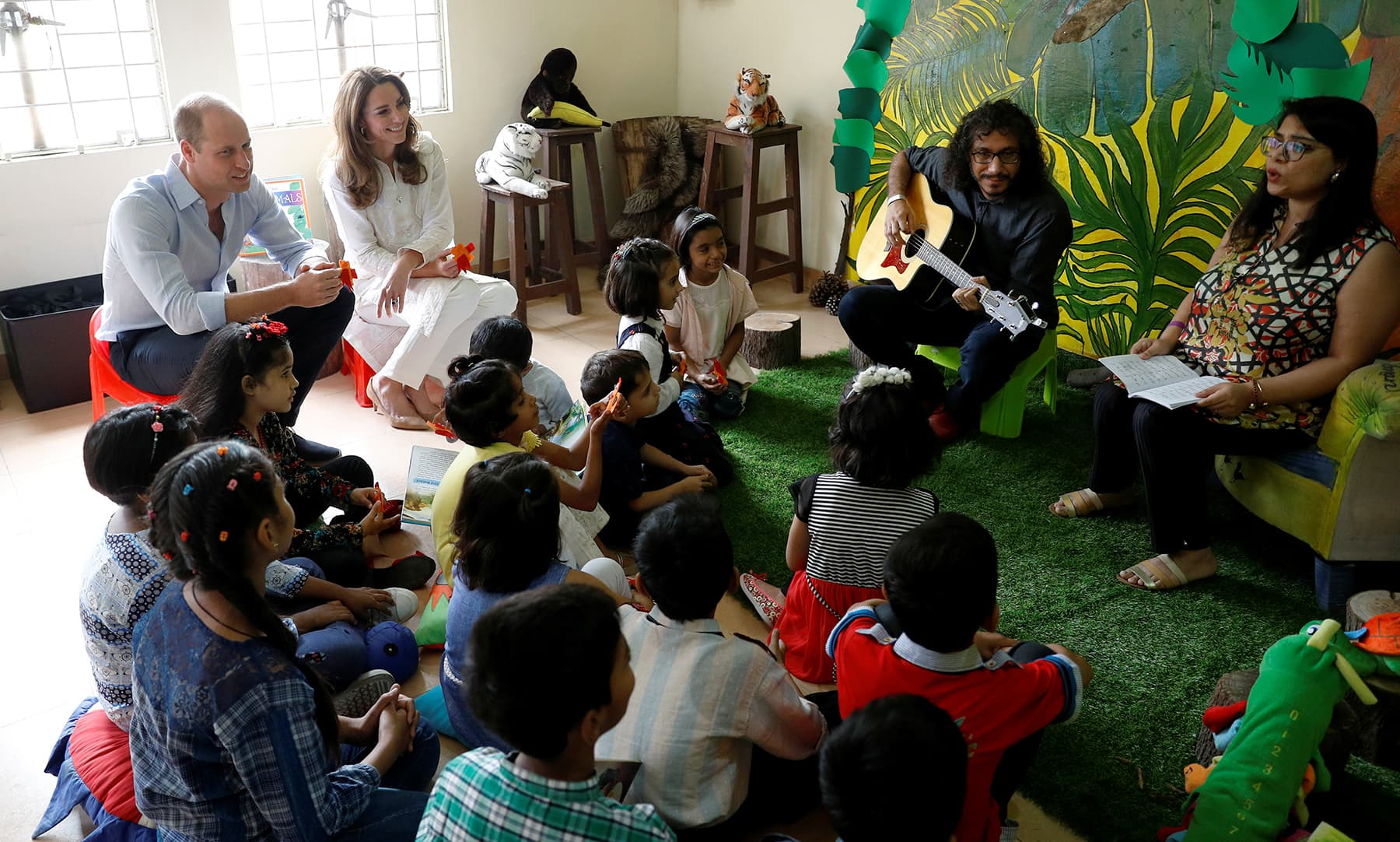 William and Kate attend a music session, at SOS Children's village in Lahore, October 17. — Reuters