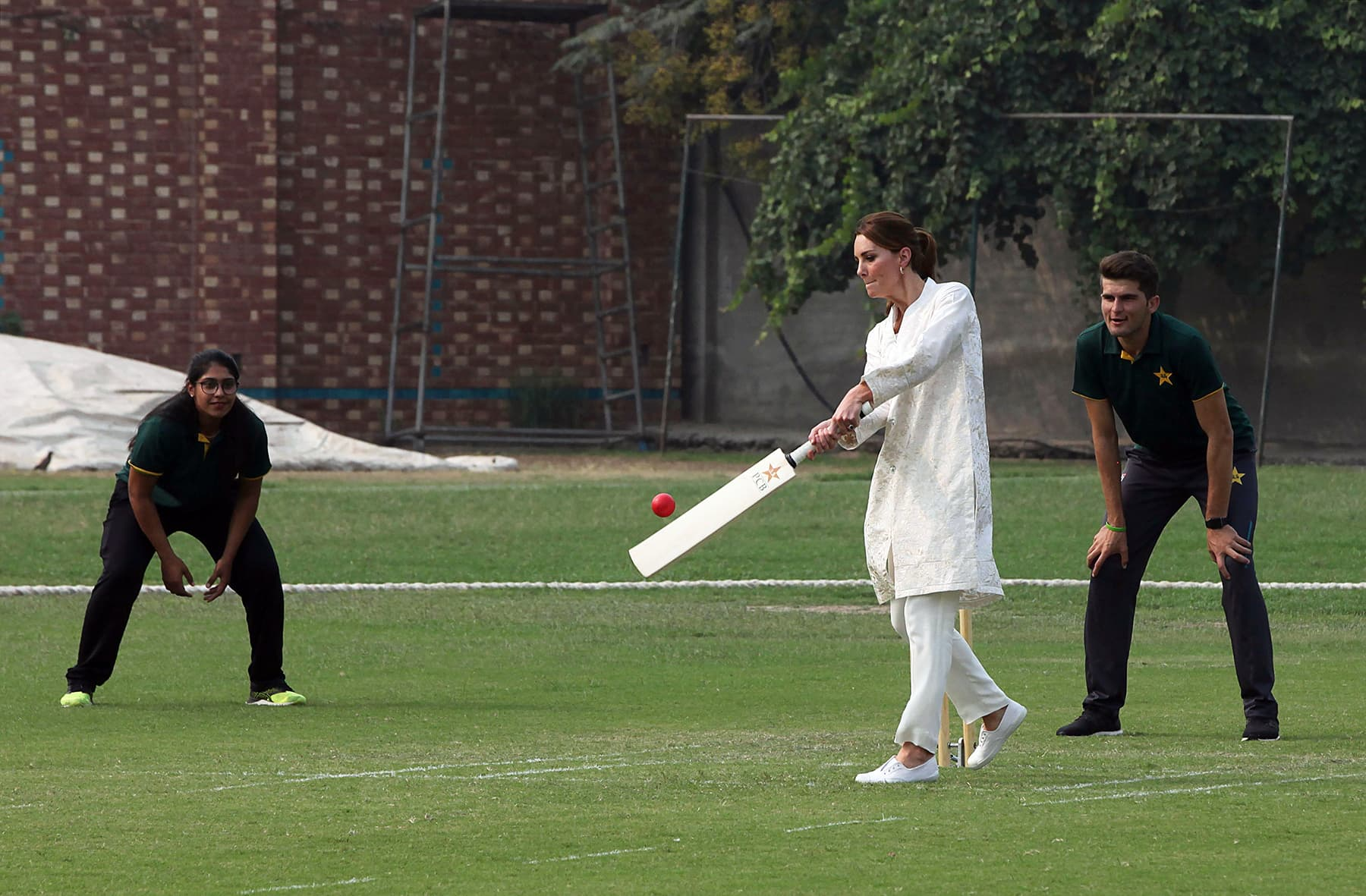 Catherine, Duchess of Cambridge, plays cricket during her visit at the National Cricket Academy in Lahore, October 17. —AFP