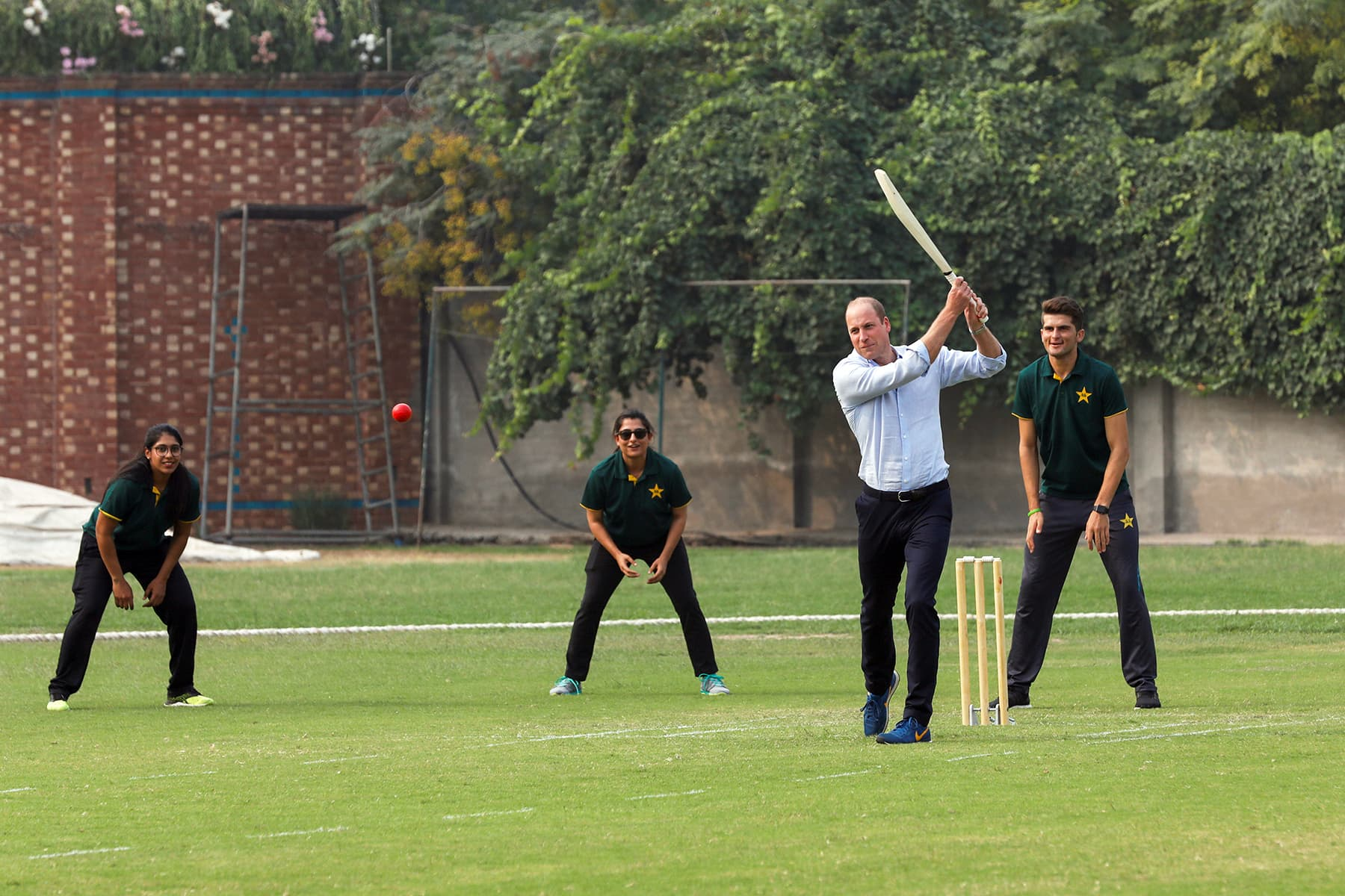 Prince William plays a shot during his visit at the National Cricket Academy in Lahore, Pakistan October 17. — Reuters