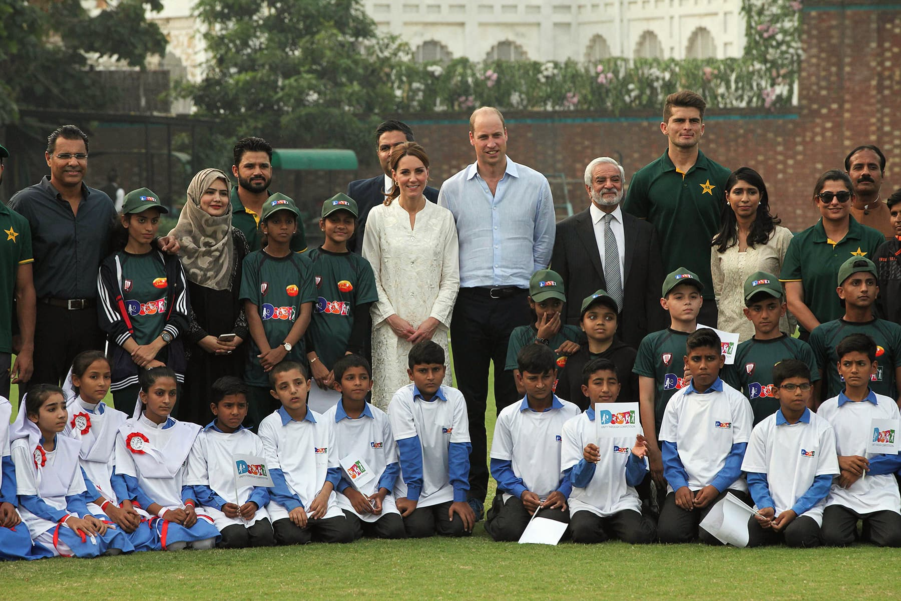 Prince William, Duke of Cambridge and his wife Catherine (C-L), Duchess of Cambridge pose for a photograph along with Pakistan Cricket Board Chairman Ehsan Mani (C-R) and cricketer Shaheen Afridi (C-2R) during their visit at the National Cricket Academy in Lahore on October 17. — AFP