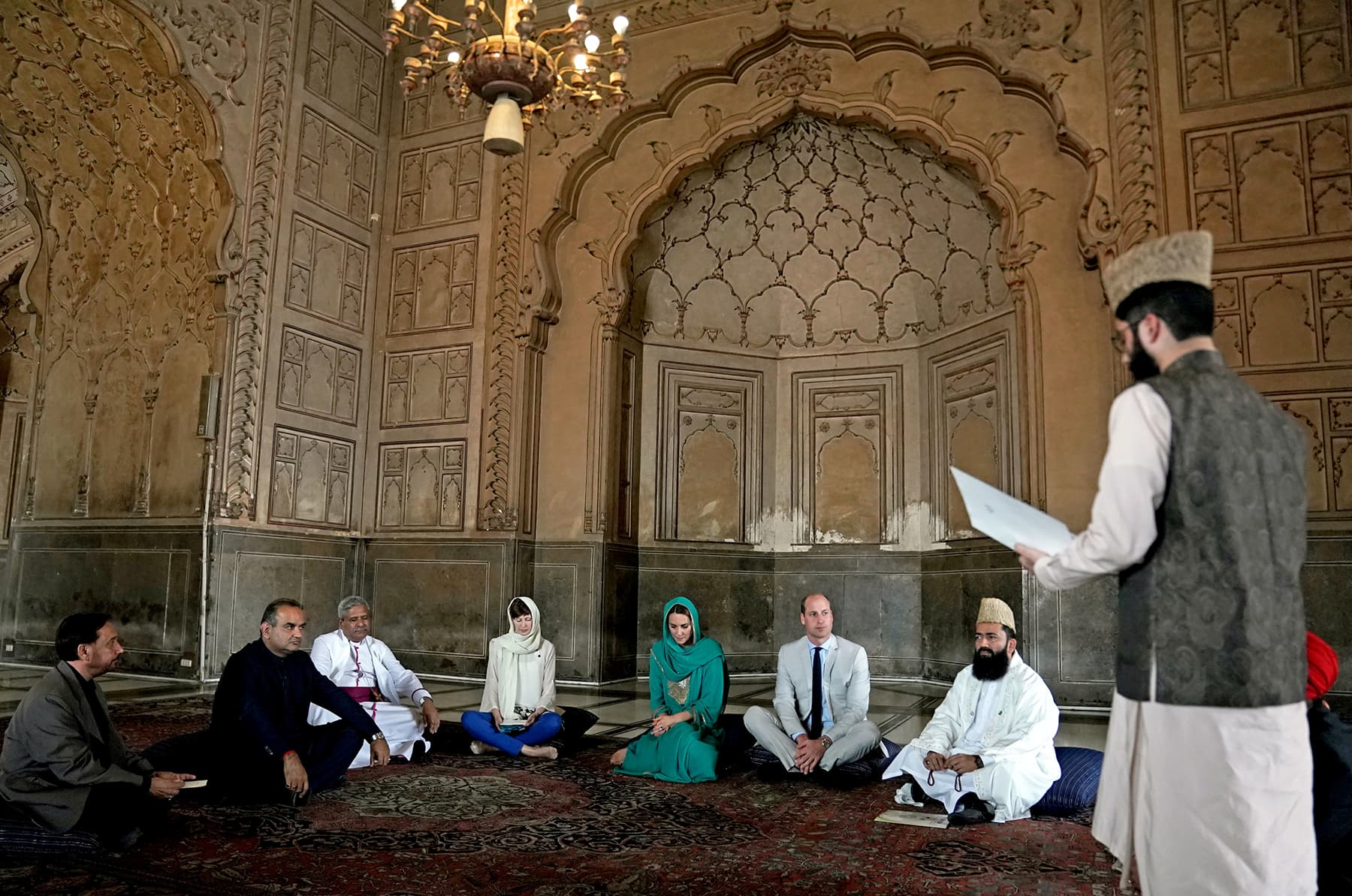 William and Catherine listen to a recitation of the Holy Quran at the Badshahi Mosque in Lahore on October 17. — Reuters