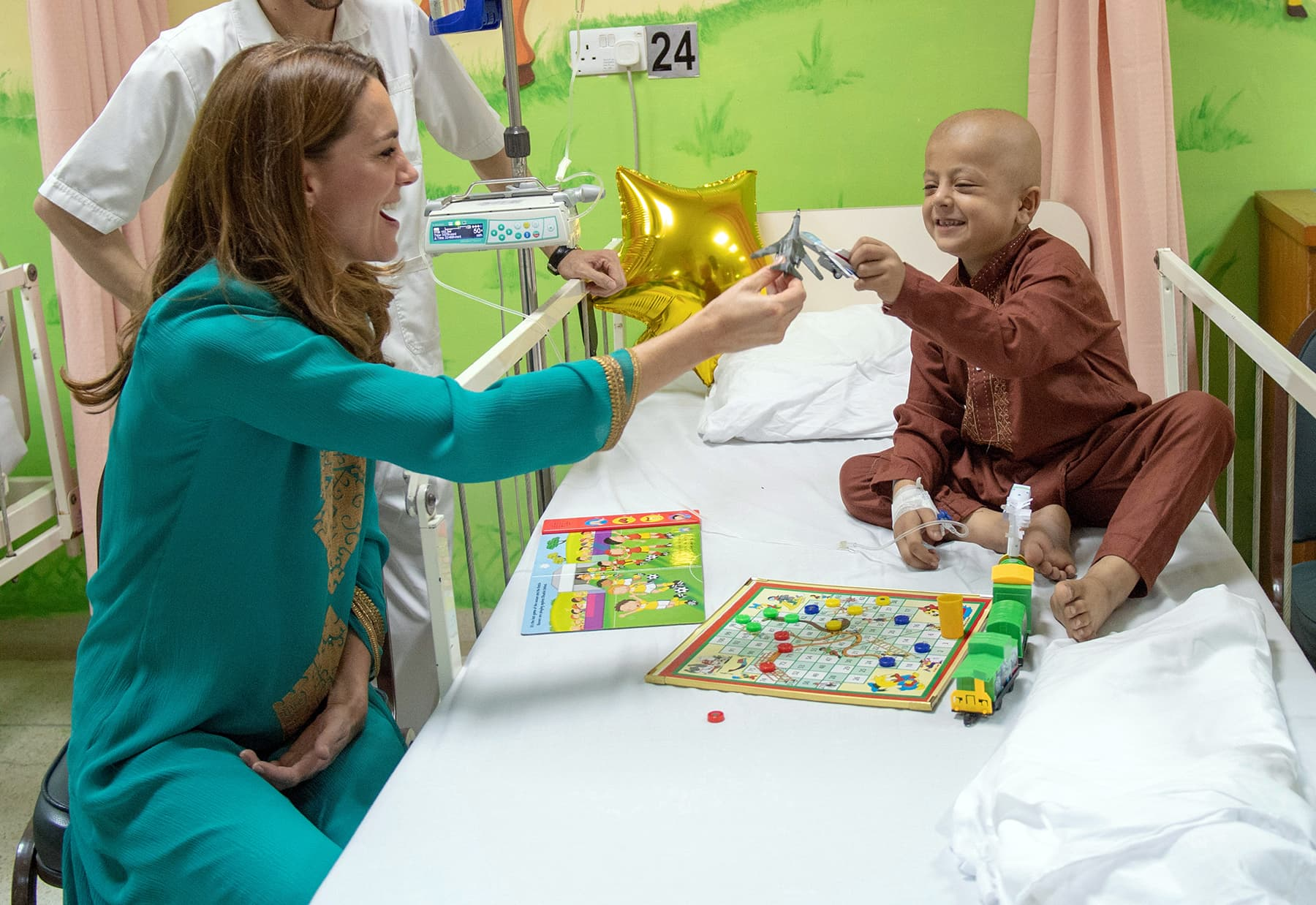 Catherine interacts with a cancer patient at the Shaukat Khanum Memorial Cancer Hospital in Lahore, October 17. — Reuters