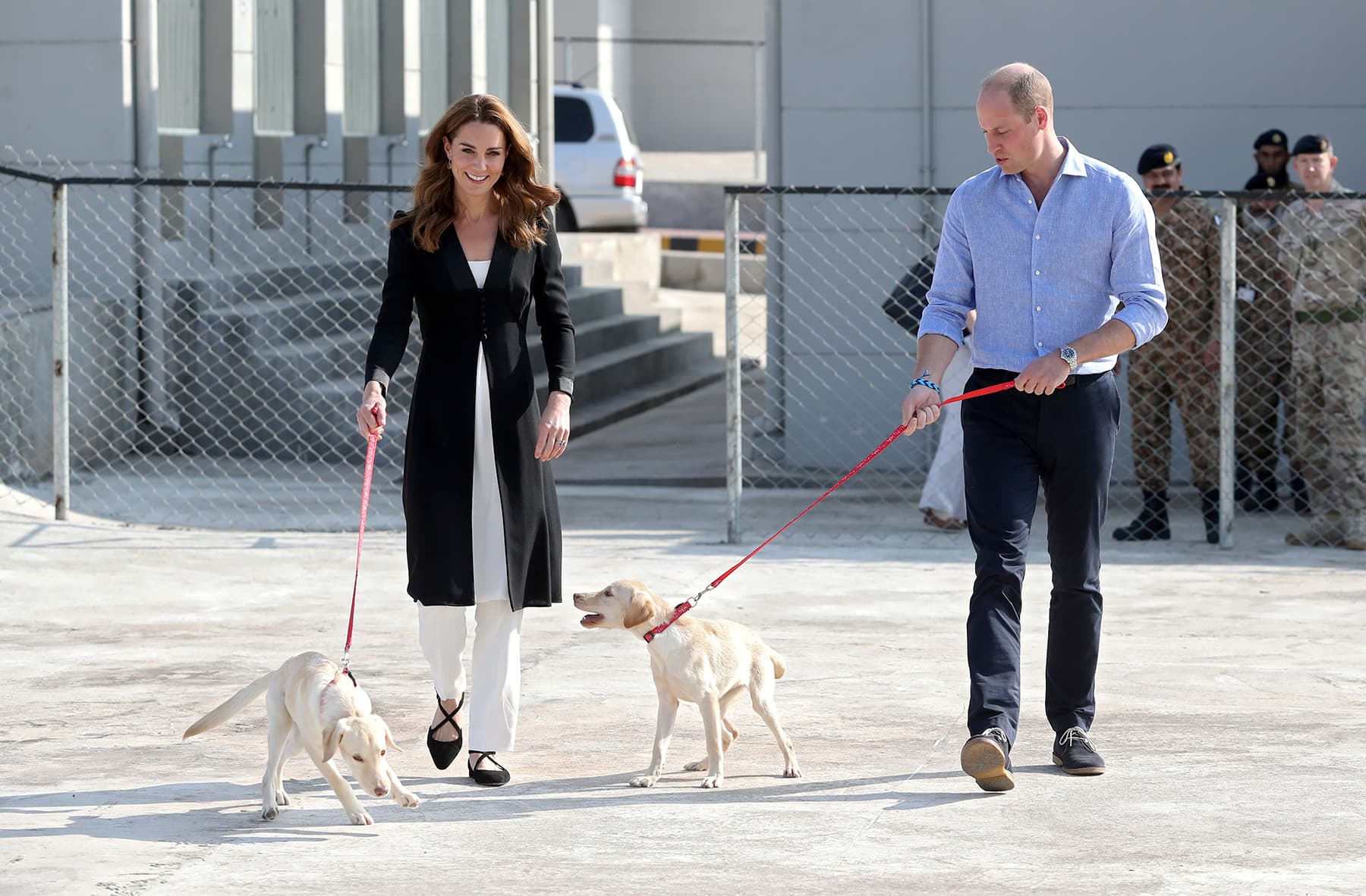 Catherine and William walk with golden labrador puppies Salto and Sky as they visit an Army Canine Centre, where Britain provides support to a programme that trains dogs to identify explosive devices, in Rawalpindi, October 18, 2019. — Reuters