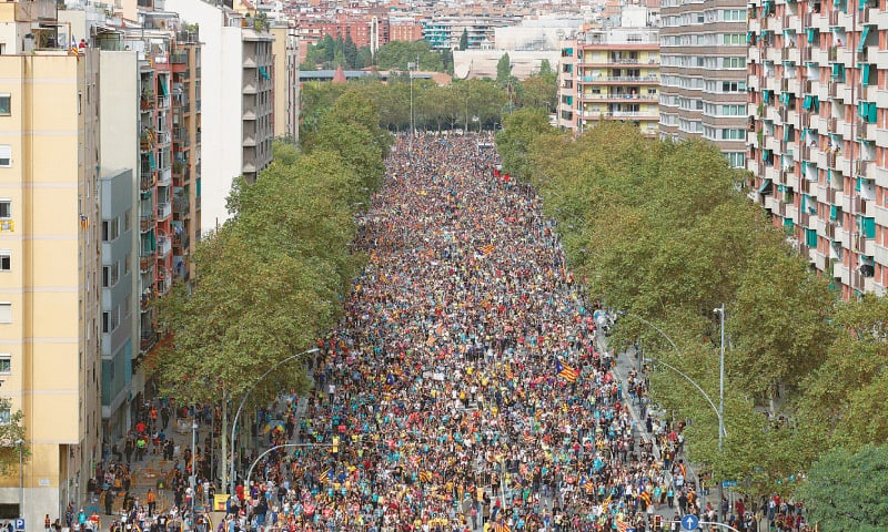 Barcelona: Demonstrators march on Meridiana Avenue during a general strike on Friday.—Reuters