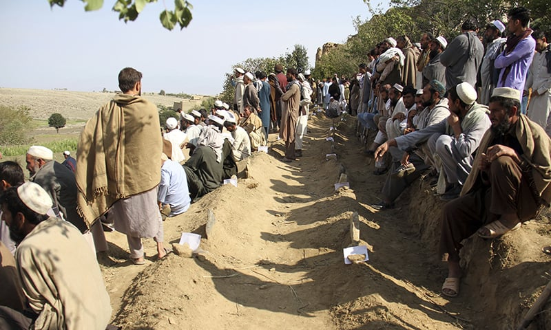 Afghan men bury victims of Friday's deadly bomb blast in the mosque in the village of Jawdara at Haska Mena district of Jalalabad east of Kabul, Afghanistan, Saturday. — AP