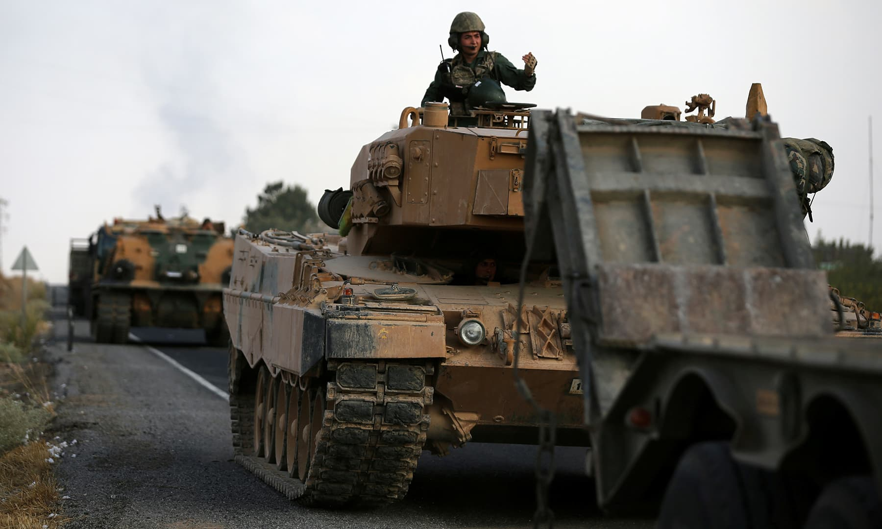 Turkish army vehicles are moving on a road near the Turkish border town of Ceylanpinar, Sanliurfa province, Turkey, October 18. — Reuters