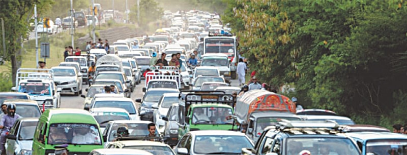 A long line of vehicles is seen on Murree Road near Lake View Park in Islamabad on a Friday as many families head towards Murree to spend the weekend | White Star