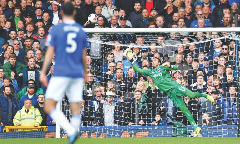 LIVERPOOL: Gylfi Sigurdsson scores Everton's second goal past West Ham United's goalkeeper Roberto during the English Premier League match at Goodison Park on Saturfay.—AFP