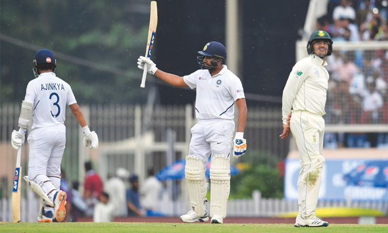 INDIAN opener Rohit Sharma raises the bat to celebrate his century during the third Test against South Africa at the JSCA International Complex on Saturday.—AFP