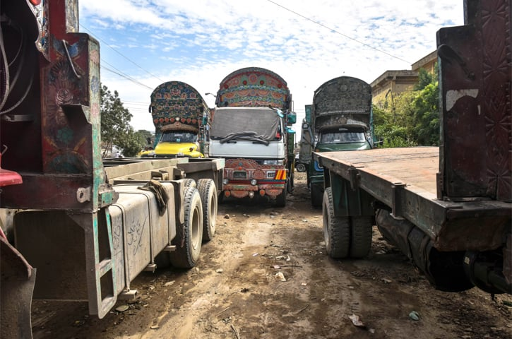 Trucks stand idle in Karachi's SITE area   Photos by Fahim Siddiqui/White Star