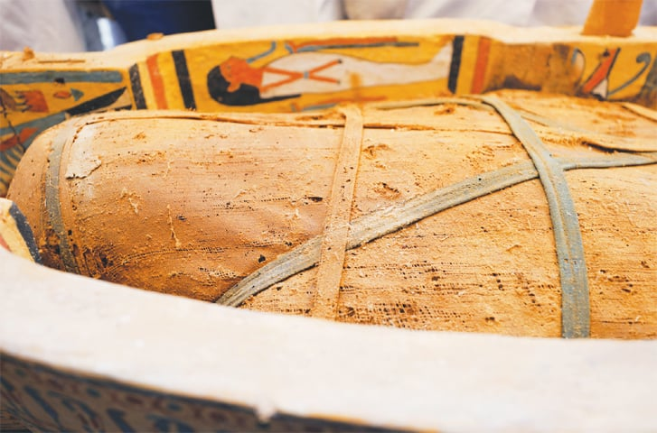 LUXOR: A mummy is seen inside a painted coffin discovered at Al Asasif Necropolis in the Valley of Kings.—Reuters