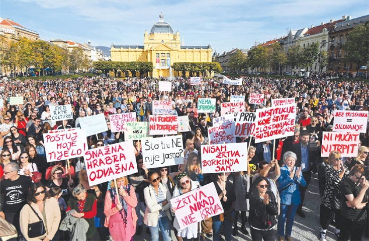 Zagreb: People hold signs during a demonstration on Saturday to protest against a judiciary system that women say is failing to protect them.—AFP