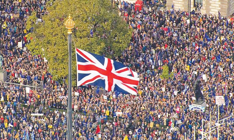 LONDON: An image grabbed from footage recorded and broadcast by the UK Broadcast Pool shows thousands of people taking part in a People's Vote march calling for a final say in the form of a second Brexit referendum on Saturday.—AFP