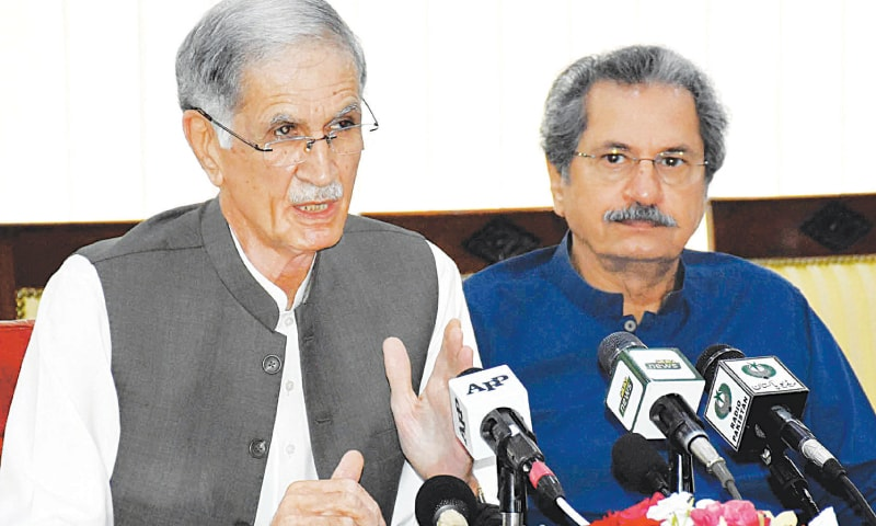 Federal Minister for Defence Pervez Khattak and Federal Minister for Education and Professional Training Shafqat Mahmood address a press conference on Saturday.—White Star