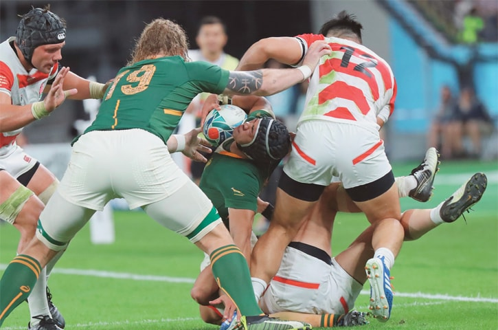 TOKYO: South Africa's Cheslin Kolbe holds the ball against the Japan defence during their Rugby World Cup quarter-final at Tokyo Stadium on Sunday.—AP