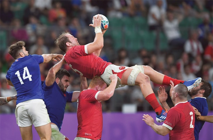 OITA: Wales' Alun Wyn Jones catches the ball during the Rugby World Cup quarter-final against France at the Oita Stadium on Sunday.—AFP