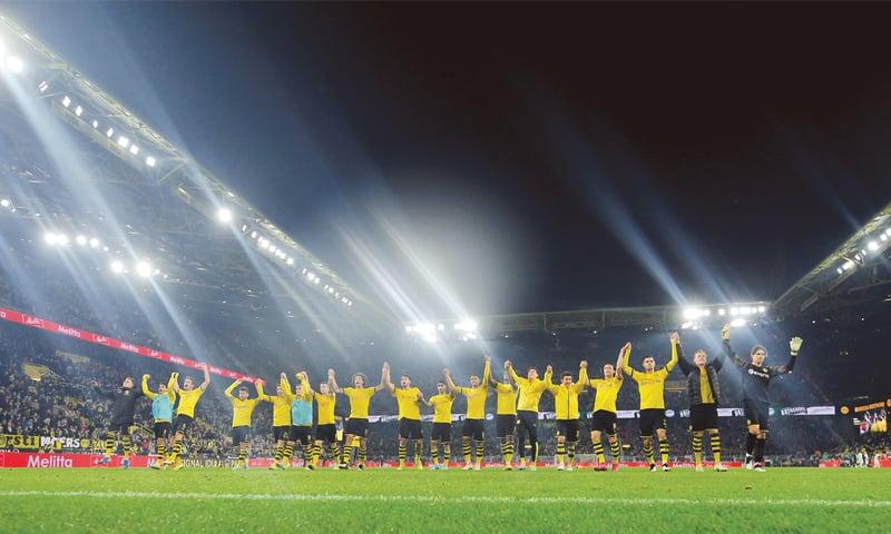 DORTMUND: Borussia Dortmund players celebrate at the end of the Bundesliga match against Borussia Moenchengladbach at Signal Iduna Park.—Reuters