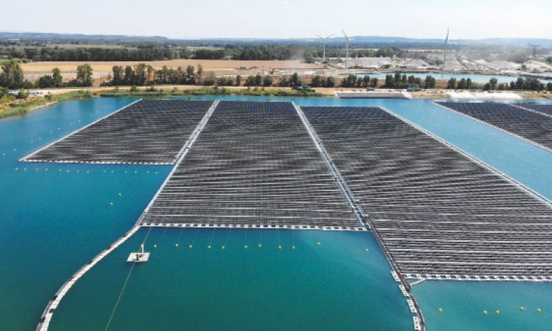 This file photo taken on August 1, 2019 shows the floating photovoltaic solar panels at the power plant O'Mega1 in Piolenc, southern France. The first floating solar energy farm in Europe by its size was be inaugurated last week.—AFP