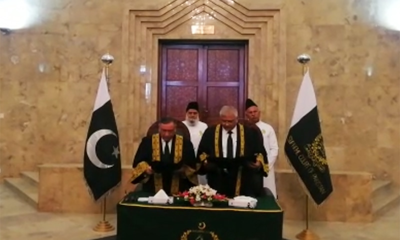 Chief Justice Asif Saeed Khosa administers oath to Justice Aminuddin Khan in a ceremony in Islamabad. — Photo courtesy screengrab