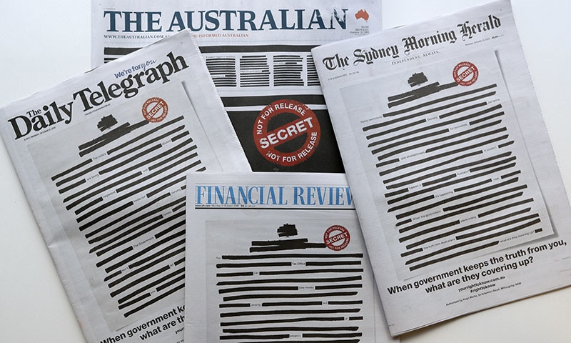 Newspapers display redacted copy on their front pages in Sydney on Oct 21. — AP