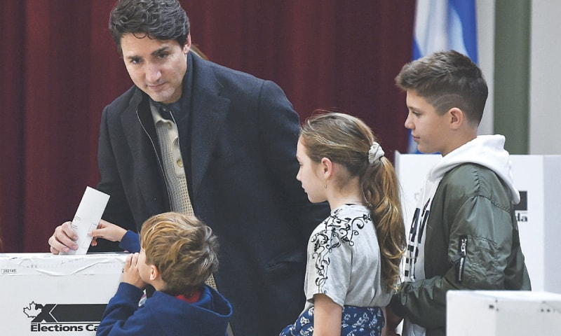 MONTREAL: Canadian Prime Minister Justin Trudeau with his three children as he votes in his district.—AFP