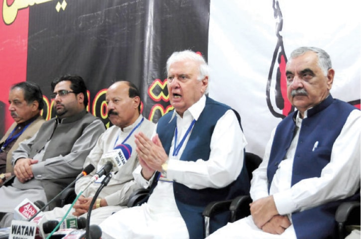 Aftab Sherpao addresses a presser in Peshawar on Monday. — INP