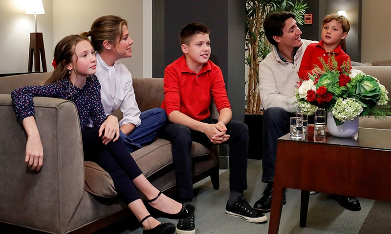 Liberal leader and Canadian Prime Minister Justin Trudeau and his wife Sophie Gregoire Trudeau, sons Xavier and Hadrien, and daughter Ella-Grace watch a television broadcast of the initial results from the federal election, in Montreal, Canada on October 21. — Reuters
