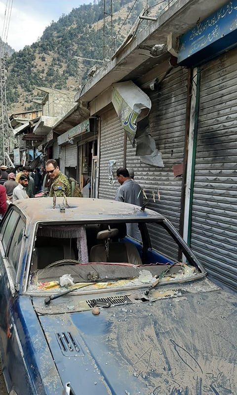 Foreign diplomats look at a car damaged by shelling from Indian troops from across the border. — Photo provided by author