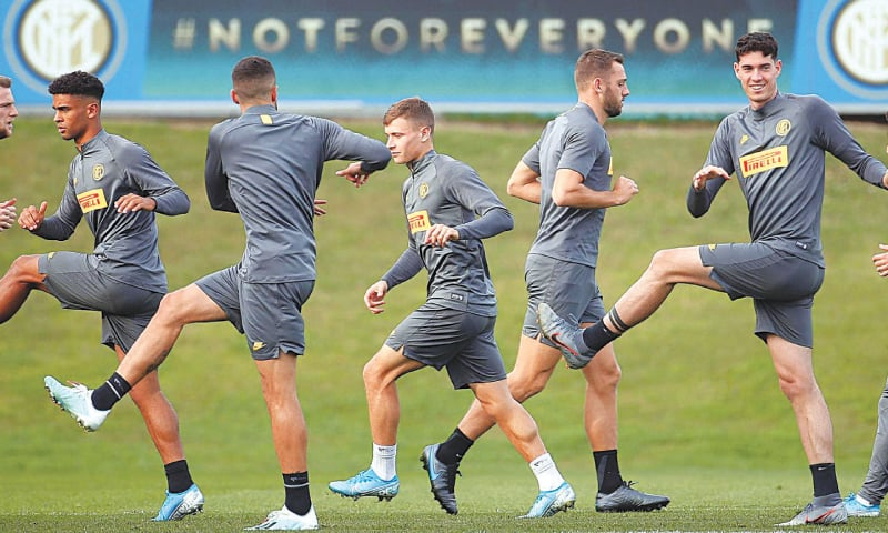 INTER Milan players attend a training session ahead of their Champions League group 'F' match against Borussia Dortmund at the Suning training centre in Appiano Gentile on Tuesday.—AP